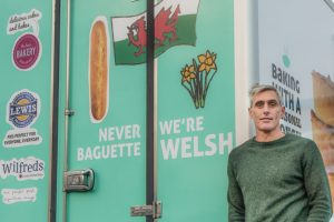 Wilf Lewis Jnr standing in front of one of our new vans